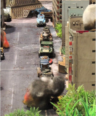 The look down main street as a Combat Car is hit by an IED