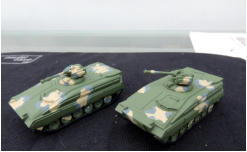 Two Sokols (Falcon) MICVs in green primer with camo applied