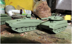 The Sokol (Falcon) MICV and the Xaoc (Havoc) medium tank in green primer